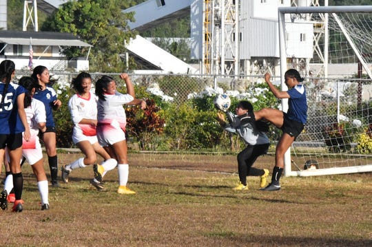 Cougar goalkeeper Phoebe Shmull secures the ball on a play near the goal during Academy's 3-1 win over St. John's Wednesday in Tumon.