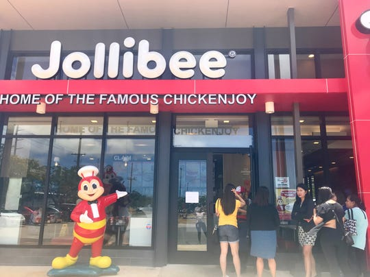 A month after Jollibee's official opening by Micronesia Mall, the Philippines' fast-food chain continues to field a swarm of customers daily. The drive-thru remains closed, for safety reasons, according to management, as patrons crowd outside, waiting their turn.