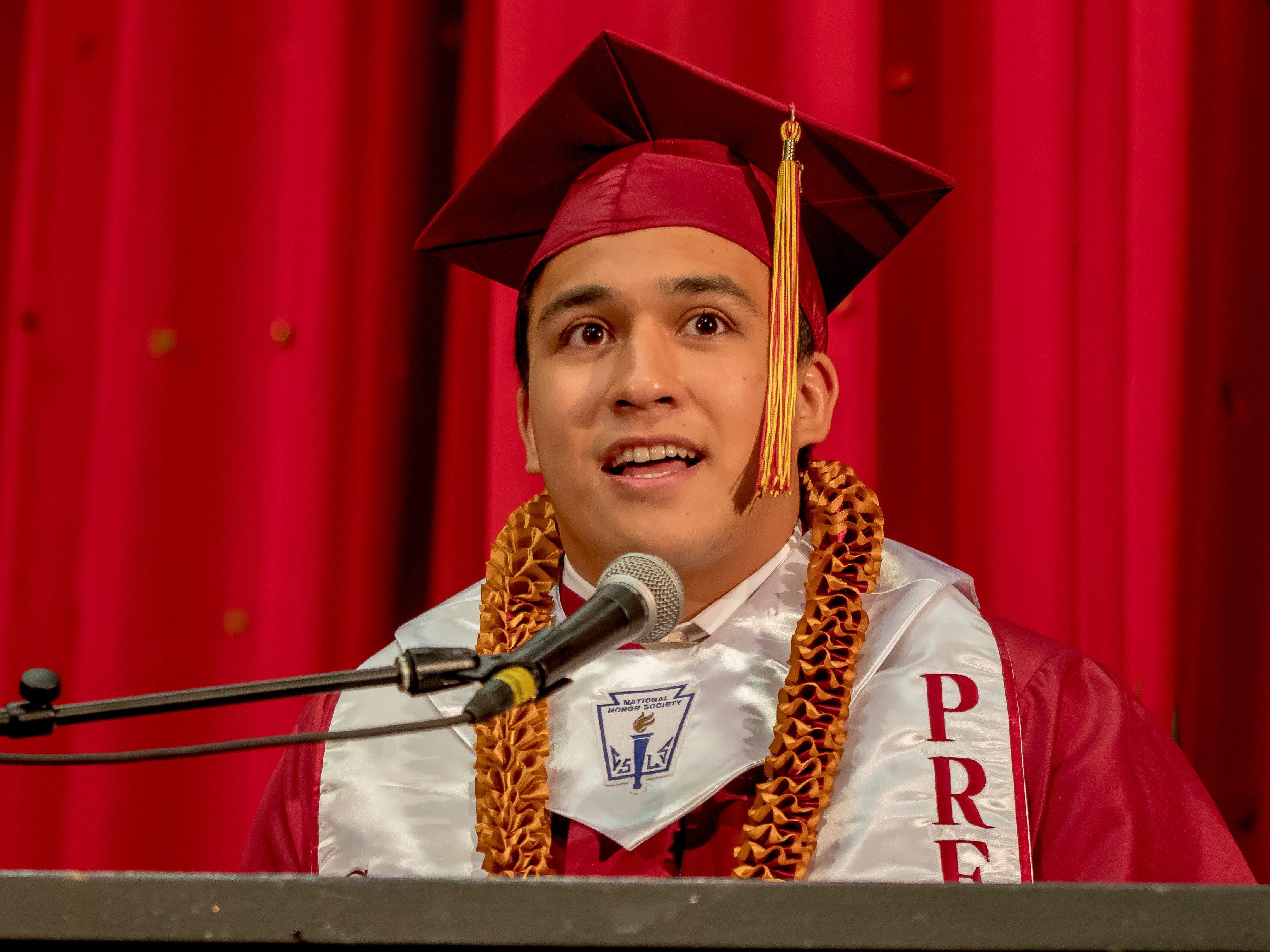 Matias Makanahiwahiwa Calvo delivers his valedictory speech during the Father Duenas Memorial School Class of 2019 commencement ceremony at the Phoenix Center on May 8, 2019.