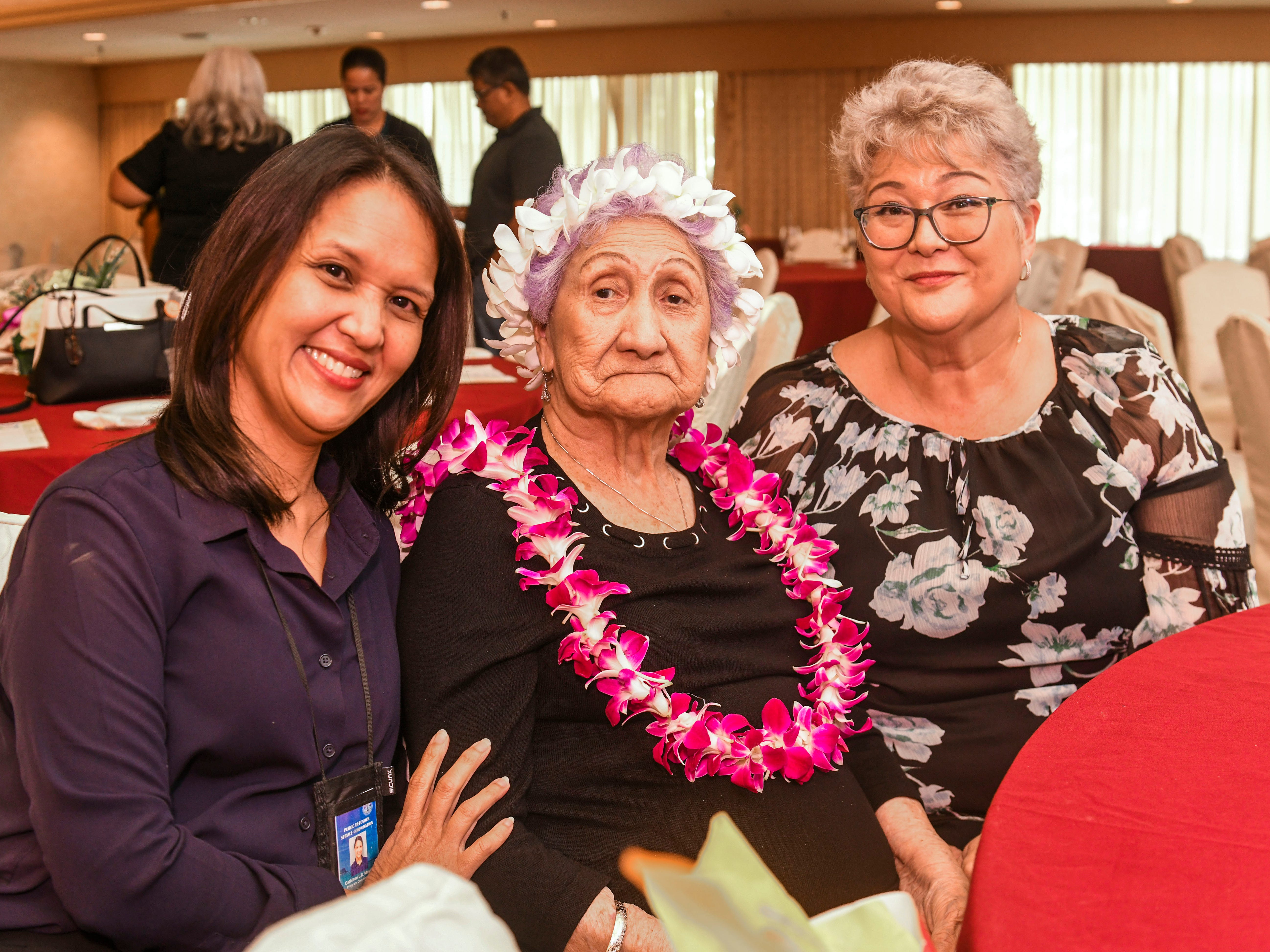 Centenarian Yuk Lan Moylan, 100, center, is flanked by her grandaughter-in-law, Cathy Moylan, left, and daughter, Leialoha Alston, during the 2019 Centenarian Celebration, hosted by the Department of Public Health and Social Services, at the Pacific Star Resort & Spa in Tumon on Thursday, May 9, 2019.