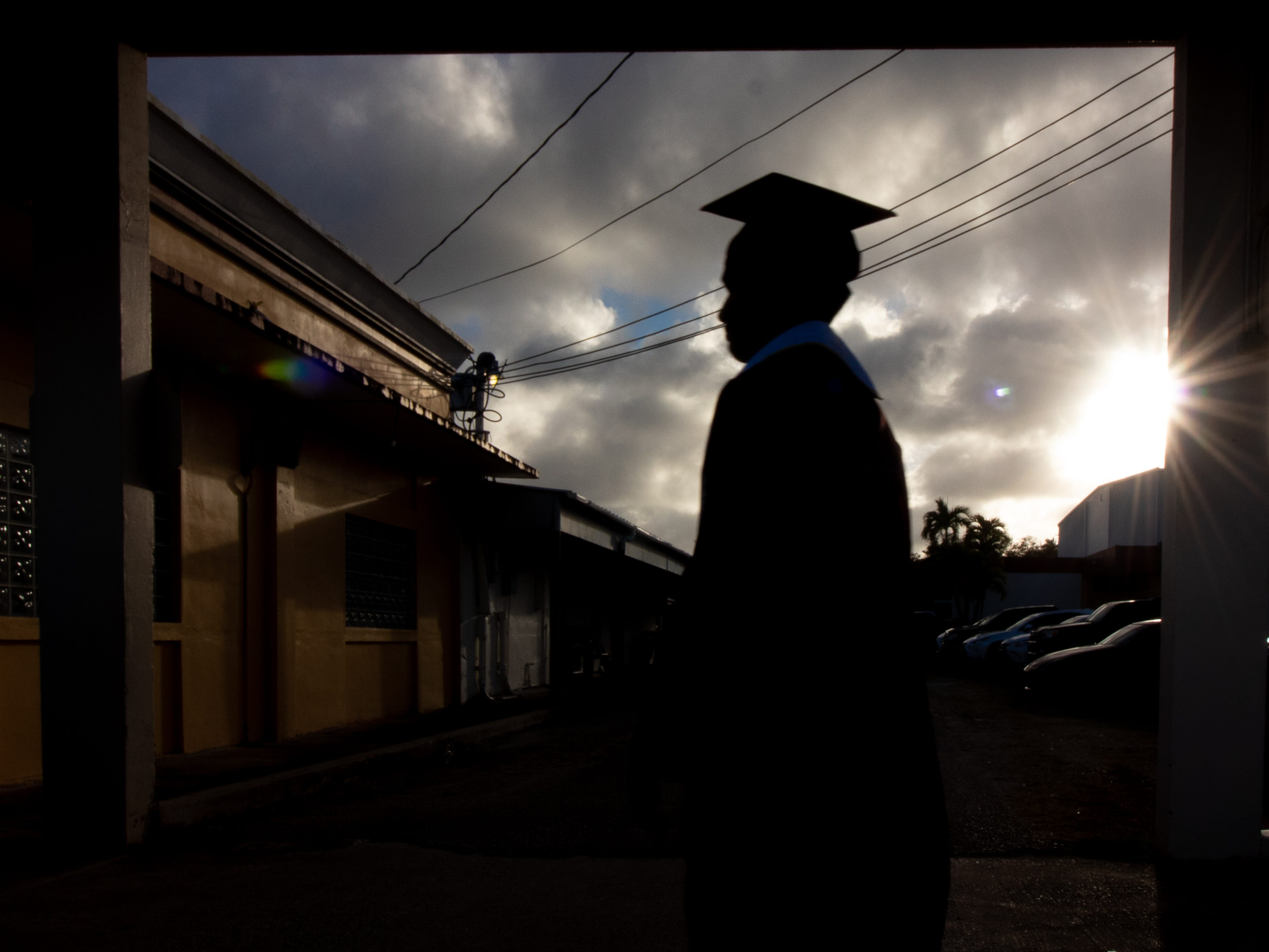 A Father Duenas Memorial School senior walks toward the chapel for a prayer before their graduation ceremony at the Phoenix Center on May 8, 2019.