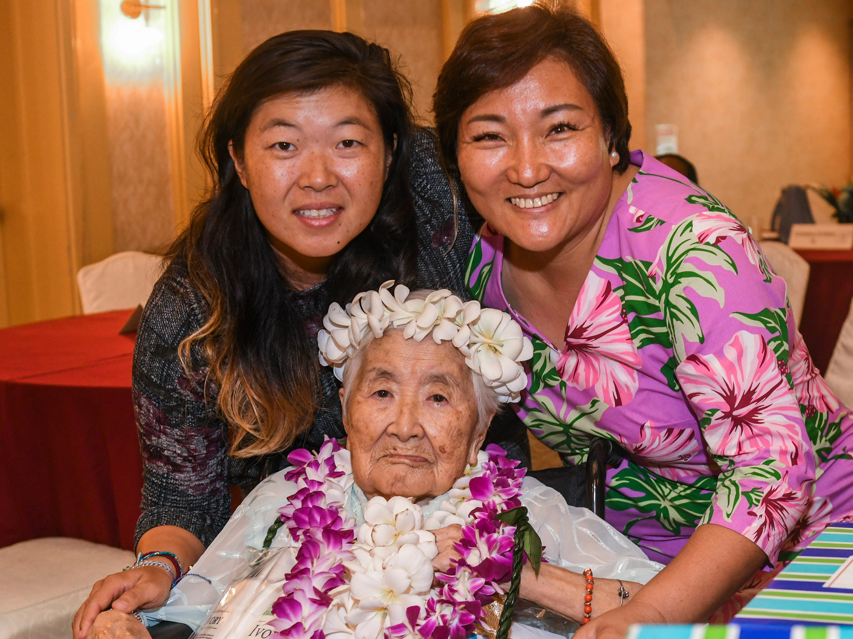 Hae Im Yu Shim, 102, seated, gathers with her grandaughter, Sue Lee, left, and Ina Lee, East Asia Tae Kwon Do Federation of Guam general secretary, during the 2019 Centenarian Celebration, hosted by the Department of Public Health and Social Services, held in conjunction with Senior Citizens Month, at the Pacific Star Resort & Spa in Tumon on Thursday, May 9, 2019.