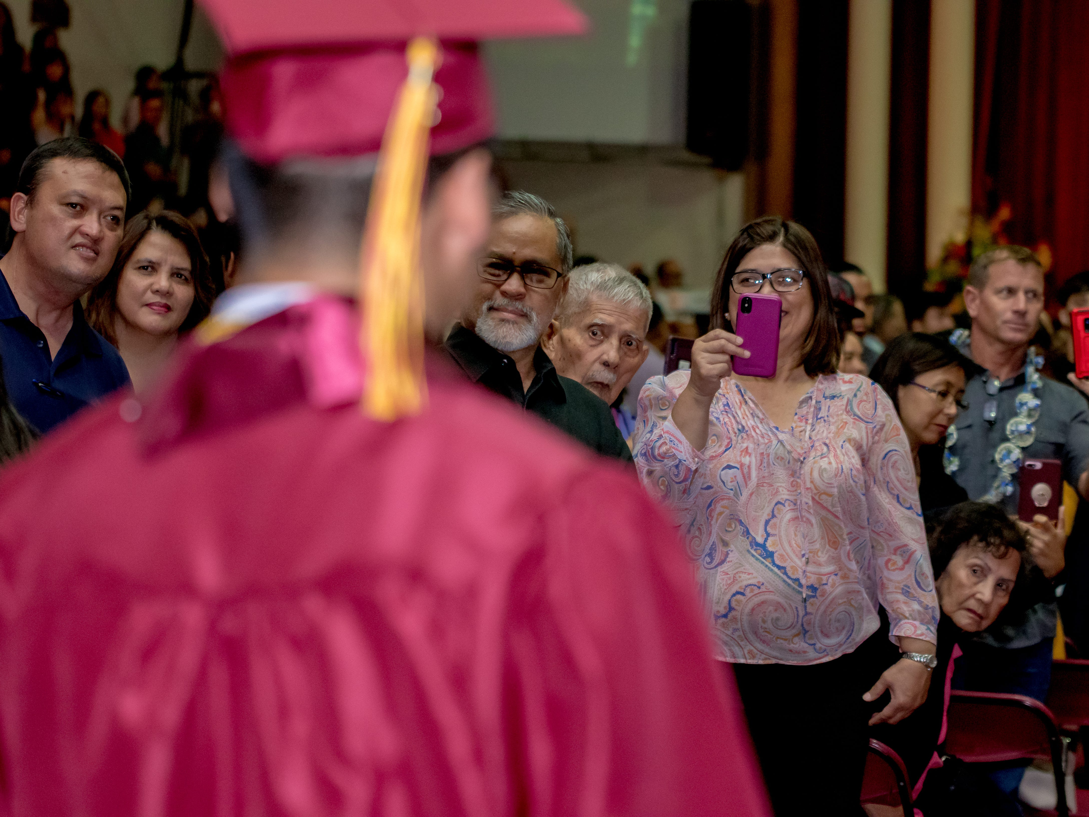 Family members find a good spot to take photos of their graduating senior during Father Duenas Memorial School's Class of 2019 commencement ceremony at its Phoenix Center on Thursday, May 8, 2019.