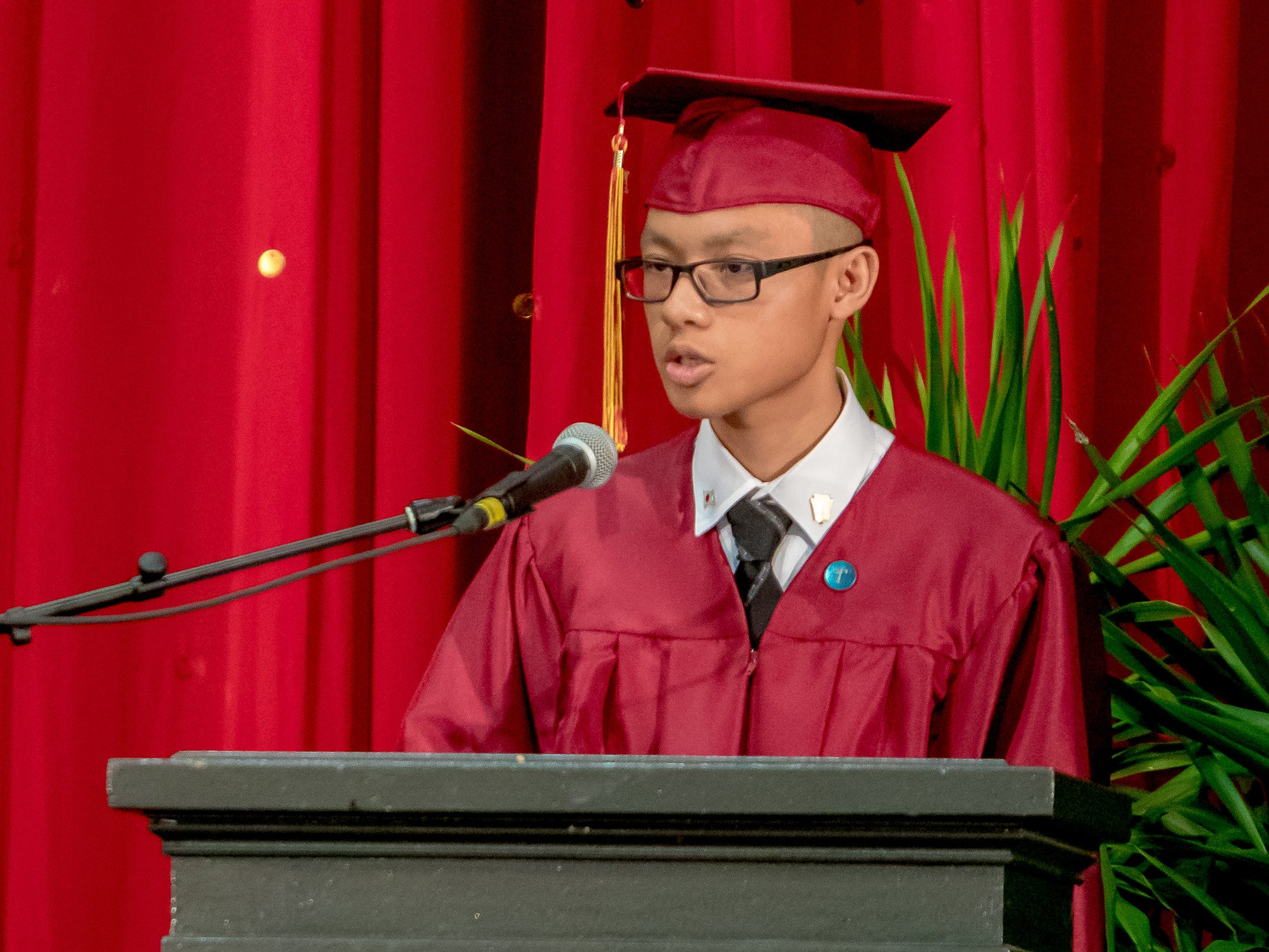 Adrian Robbie Edusada delivers his salutatory speech during the Father Duenas Memorial School Class of 2019 commencement ceremony held at the Phoenix Center on May 8, 2019.