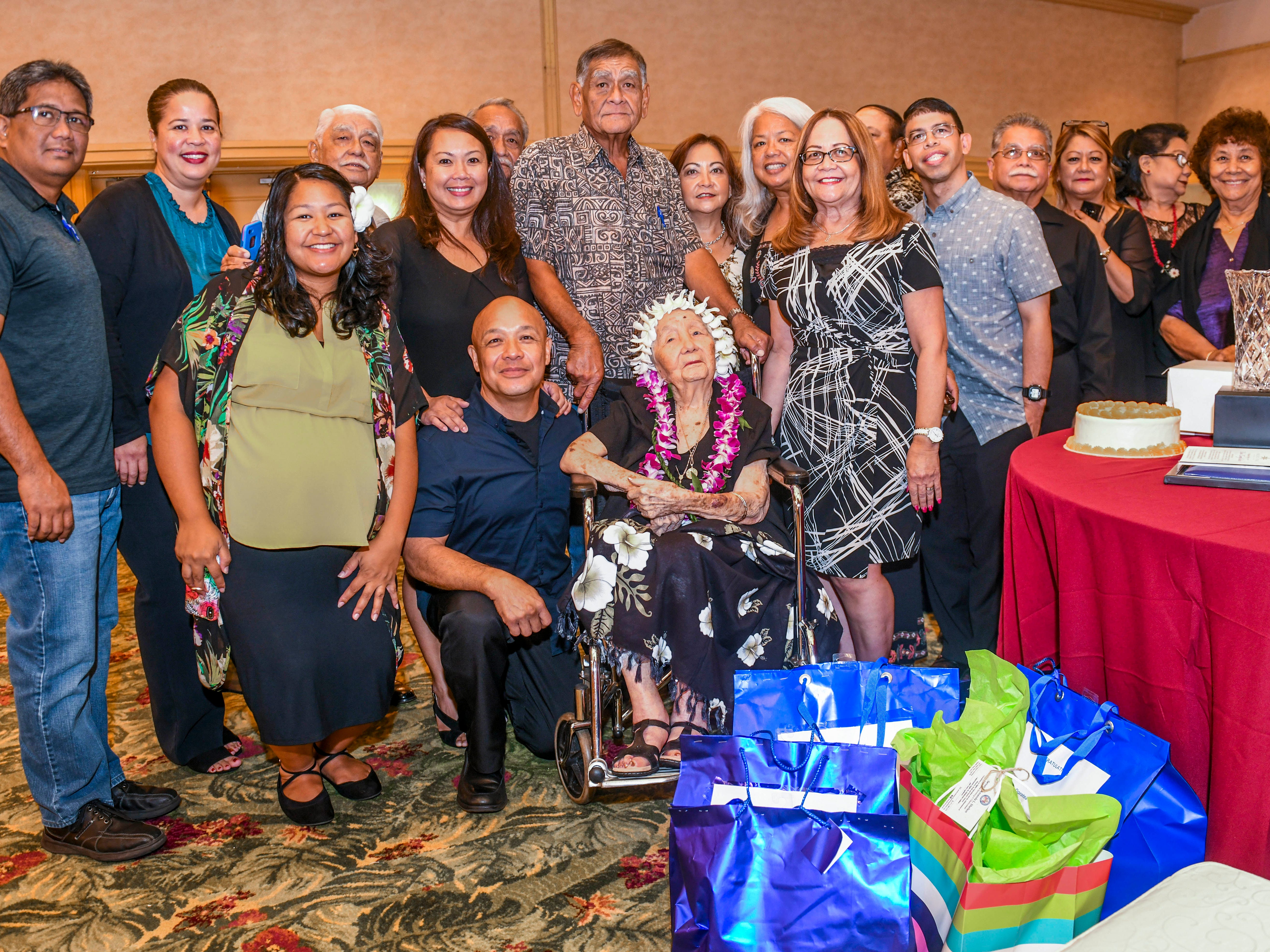 Josephina Dorotea Yamanaka Blas, seated, gathers with family and friends during the 2019 Centenarian Celebration, hosted by the Department of Public Health and Social Services, held in conjunction with Senior Citizens Month, at the Pacific Star Resort & Spa in Tumon on Thursday, May 9, 2019. Coincidentally, the event fell on Blas' birthday being born on May 9, 1915.