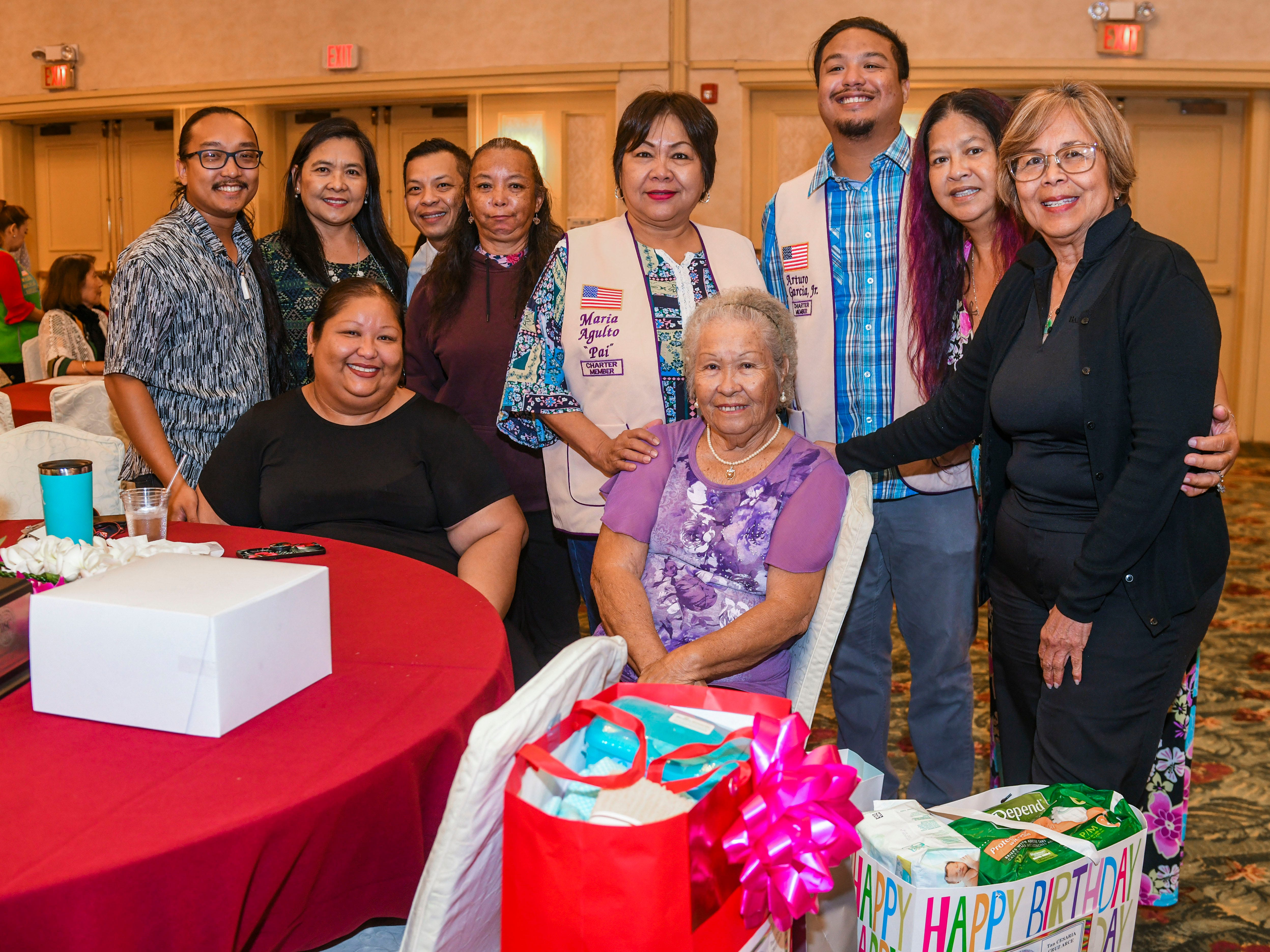 Family representatives for centenarian Cesaria Cruz Arce is presented with gifts for her from the Guanhan Isan Famagu'on Lions Club during the 2019 Centenarian Celebration at the Pacific Star Resort & Spa in Tumon on Thursday, May 9, 2019. The event, hosted by the Department of Public Health and Social Services, was held in conjunction with Senior Citizens Month.