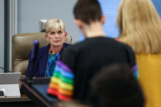 "Hamilton Southeastern Schools board Vice President Sylvia Shepler listens to stories and statements from students, including Tasmin Crosby, at right, during the Hamilton Southeastern Schools board meeting at Cumberland Road Elementary in Fishers, Ind., Wednesday, May 8, 2019. Crosby said she was offended by Shepler's past comments that suggested identifying as LGBTQ has become a ""cool"" or ""popular"" trend, given the hardships Crosby said she has faced as a lesbian."