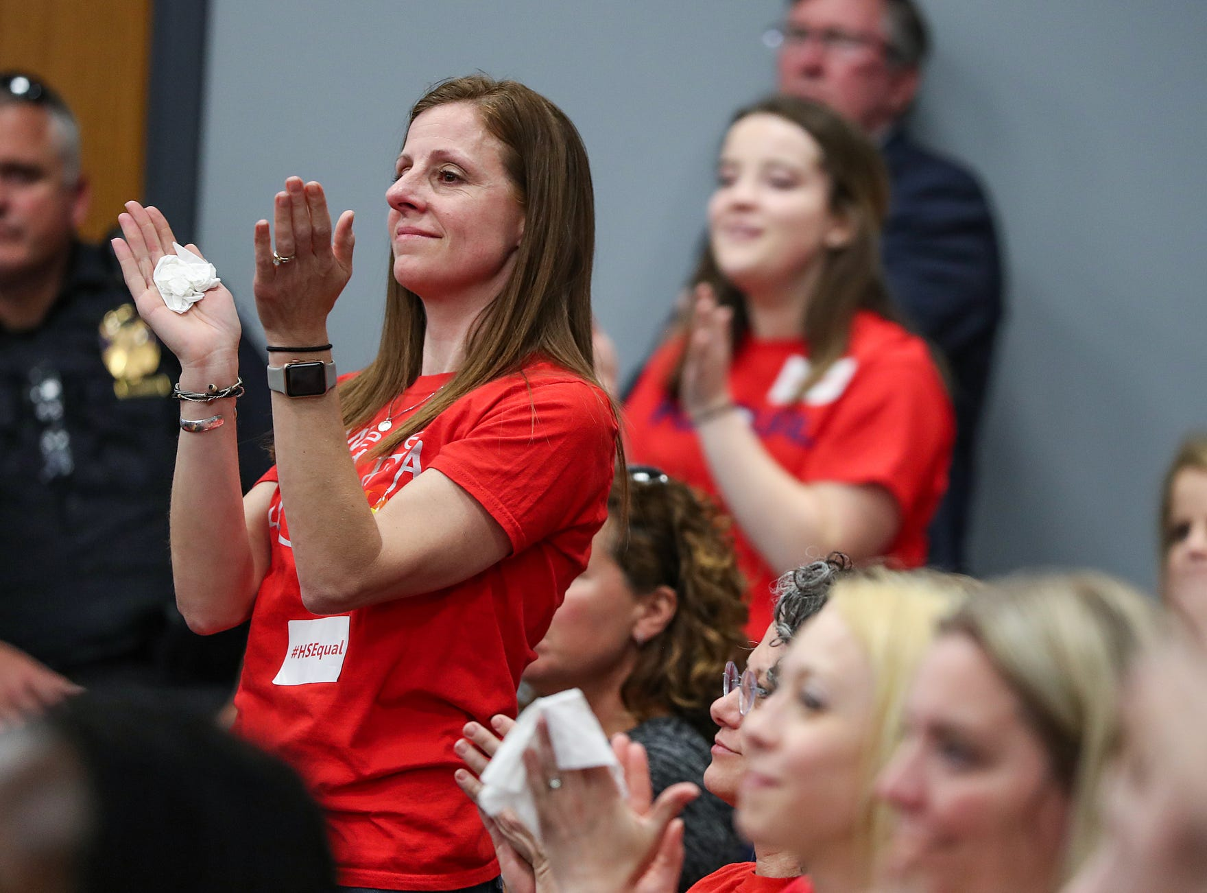 Renee Isom, a Fishers Highs School librarian, claps for students as they share personal stories and statements during the Hamilton Southeastern Schools board meeting at Cumberland Road Elementary in Fishers, Ind., Wednesday, May 8, 2019. The board voted 5-2 to adopt an anti-discrimination policy including language specifically prohibiting discrimination and harassment based on gender identity and sexual orientation.