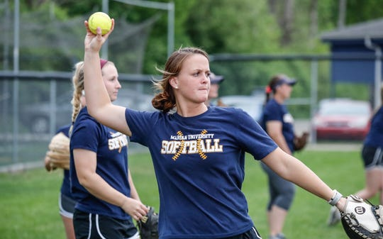 Marian University Knights softball player, Sadie Baugh, warms up with her team during practice at the schools softball field on Thursday, May 9, 2019. The team has gone 49-0 this season.