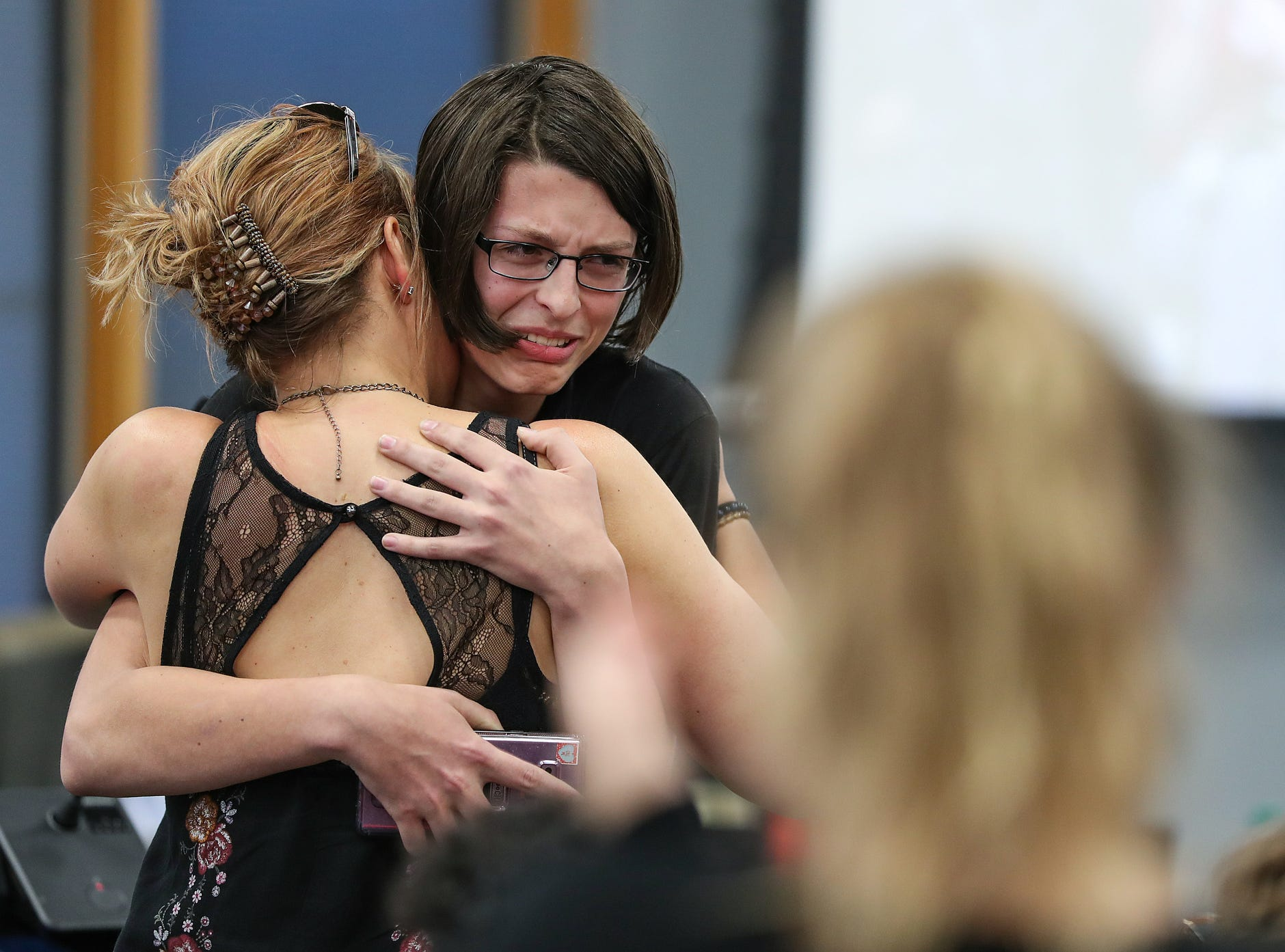 From right, Hamilton Southeastern senior Callie Waligora hugs her mother Jennifer Waligora, after Callie delivered an emotional personal statement at the Hamilton Southeastern Schools board meeting at Cumberland Road Elementary in Fishers, Ind., Wednesday, May 8, 2019. The board voted 5-2 to adopt an anti-discrimination policy including language specifically prohibiting discrimination and harassment based on gender identity and sexual orientation.
