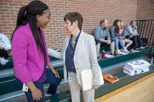 Tamika Catchings (left) chats with Fever president and COO Allison Barber May 9, 2019.