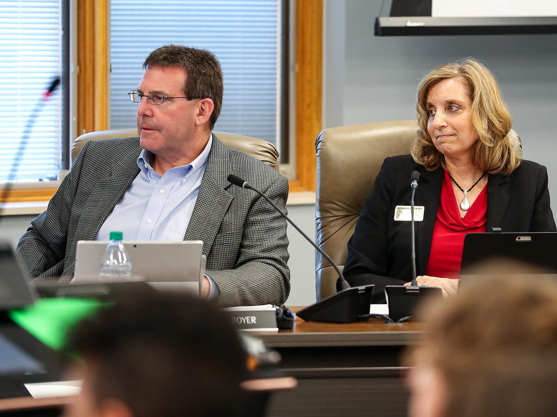 From left, board members Brad Boyer and Michelle Fullhart listen during the Hamilton Southeastern Schools board meeting at Cumberland Road Elementary in Fishers, Ind., Wednesday, May 8, 2019. The board voted 5-2 to adopt an anti-discrimination policy including language specifically prohibiting discrimination and harassment based on gender identity and sexual orientation.