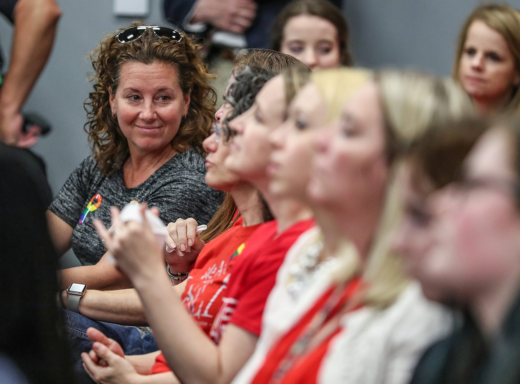 At left, Shelly Fitzgerald, the Roncalli counselor who was disciplined for her same-sex marriage, attends the Hamilton Southeastern Schools board meeting at Cumberland Road Elementary in Fishers, Ind., Wednesday, May 8, 2019. The board voted 5-2 to adopt an anti-discrimination policy including language specifically prohibiting discrimination and harassment based on gender identity and sexual orientation.