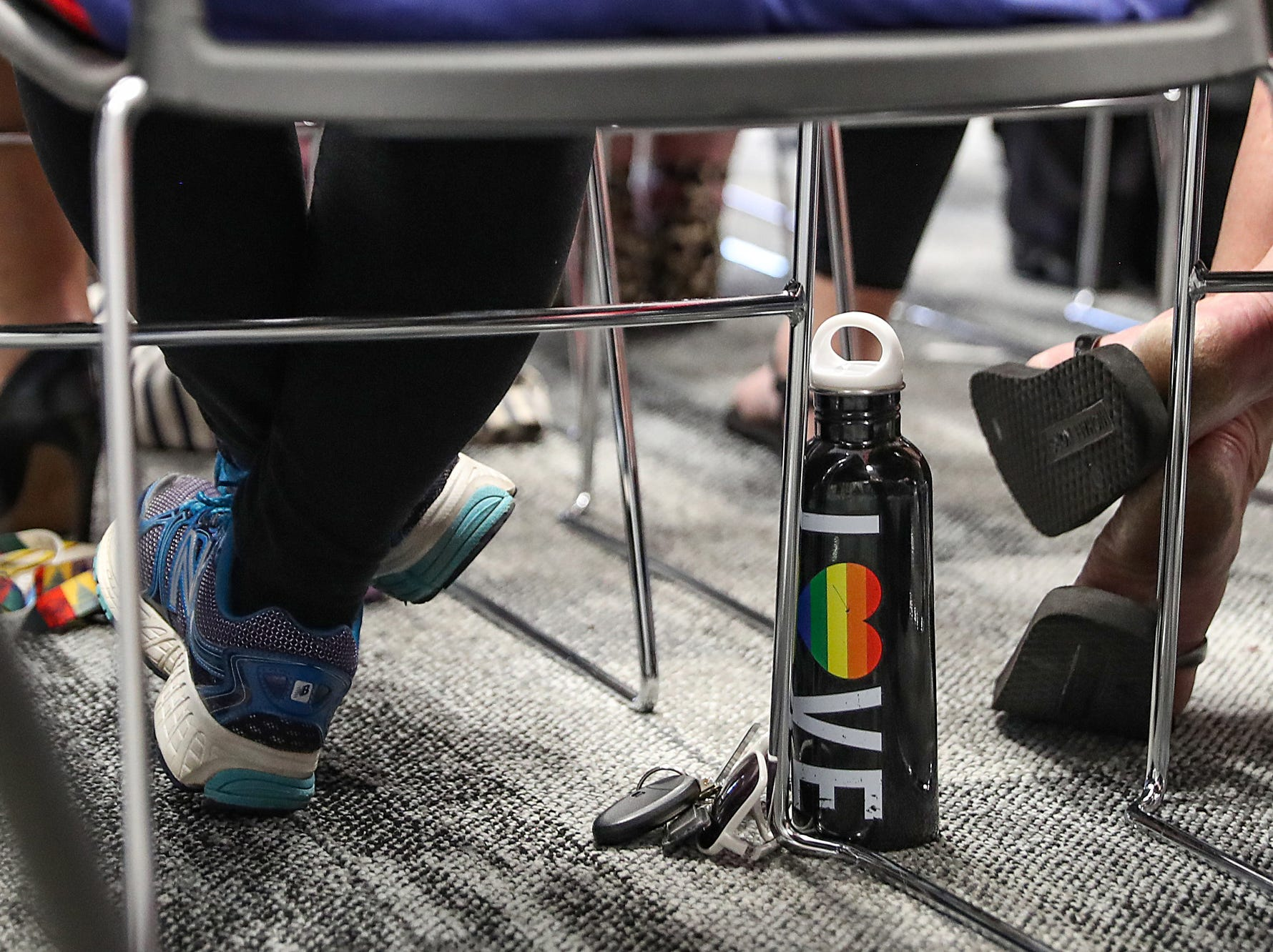 A pride water bottle sits under a chair during the Hamilton Southeastern Schools board meeting at Cumberland Road Elementary in Fishers, Ind., Wednesday, May 8, 2019. The board voted 5-2 to adopt an anti-discrimination policy including language specifically prohibiting discrimination and harassment based on gender identity and sexual orientation.