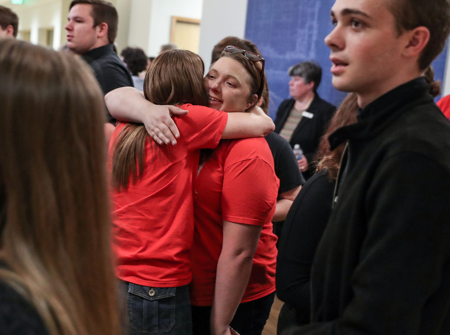 Students and other supporters celebrate the outcome of the Hamilton Southeastern Schools board meeting at Cumberland Road Elementary in Fishers, Ind., Wednesday, May 8, 2019. The board voted 5-2 to adopt an anti-discrimination policy including language specifically prohibiting discrimination and harassment based on gender identity and sexual orientation.