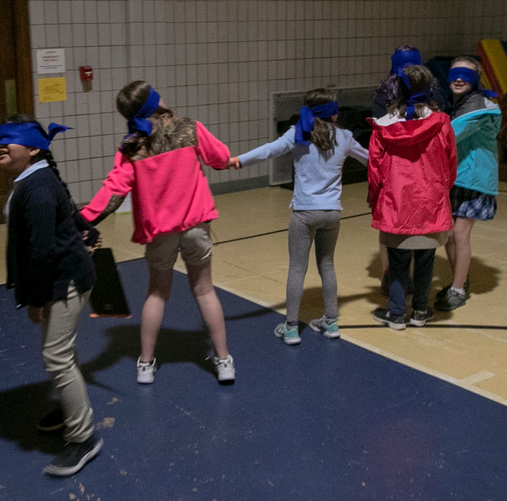 Soaked, blindfolded and fenced in: Refugee simulation builds empathy for Indy students