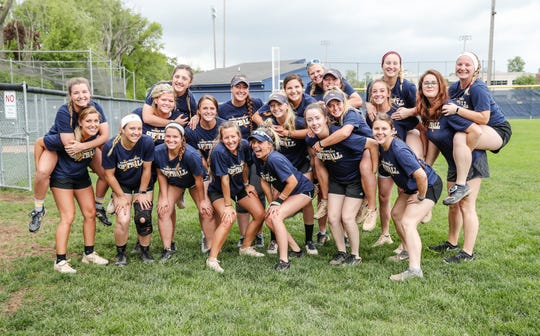 The Marian University softball team poses for a photo before practice at the schools softball field on Thursday, May 9, 2019.