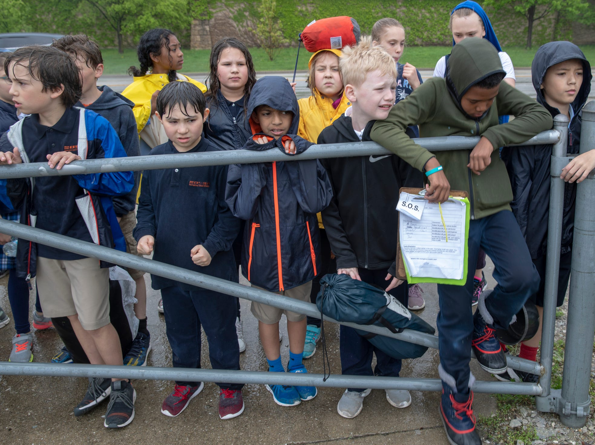 Students wait by a simulated border gate during a workshop for fourth graders at International School of Indiana, Indianapolis, Thursday, May 1, 2019. The exercise, developed by the United Nations, is designed to simulate some of the hardships that refugees face when they're trying to leave their homeland.
