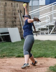 Marian University Knights softball pitcher, Shelby Herron, warms up her arm during practice at the schools softball field on Thursday, May 9, 2019. The team has gone 49-0 this season.