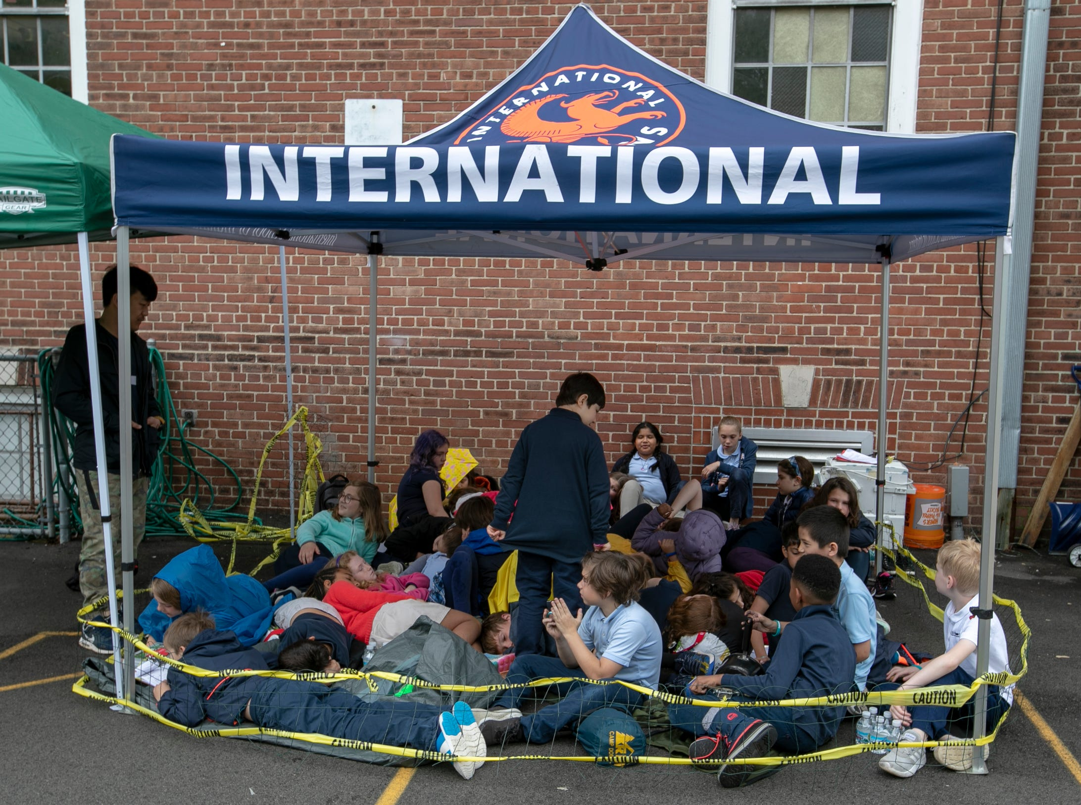 Students crowd into a pen for about twenty minutes during a workshop for fourth graders at International School of Indiana, Indianapolis, Thursday, May 1, 2019. The exercise, developed by the United Nations, is designed to simulate some of the hardships that refugees face when they're trying to leave their homeland.