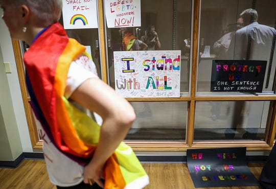 Signs hang outside the Hamilton Southeastern Schools board meeting at Cumberland Road Elementary in Fishers, Ind., Wednesday, May 8, 2019. The board voted 5-2 to adopt an anti-discrimination policy including language specifically prohibiting discrimination and harassment based on gender identity and sexual orientation.