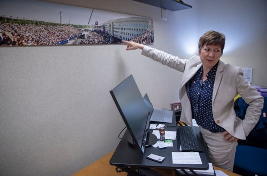 Allison Barber, new President and Chief Operating Officer of the Indiana Fever, shows a one-year memorial at the Pentagon bombing site where she worked for several years, in her office at Bankers Life Fieldhouse, Indianapolis, Thursday, May 9, 2019.