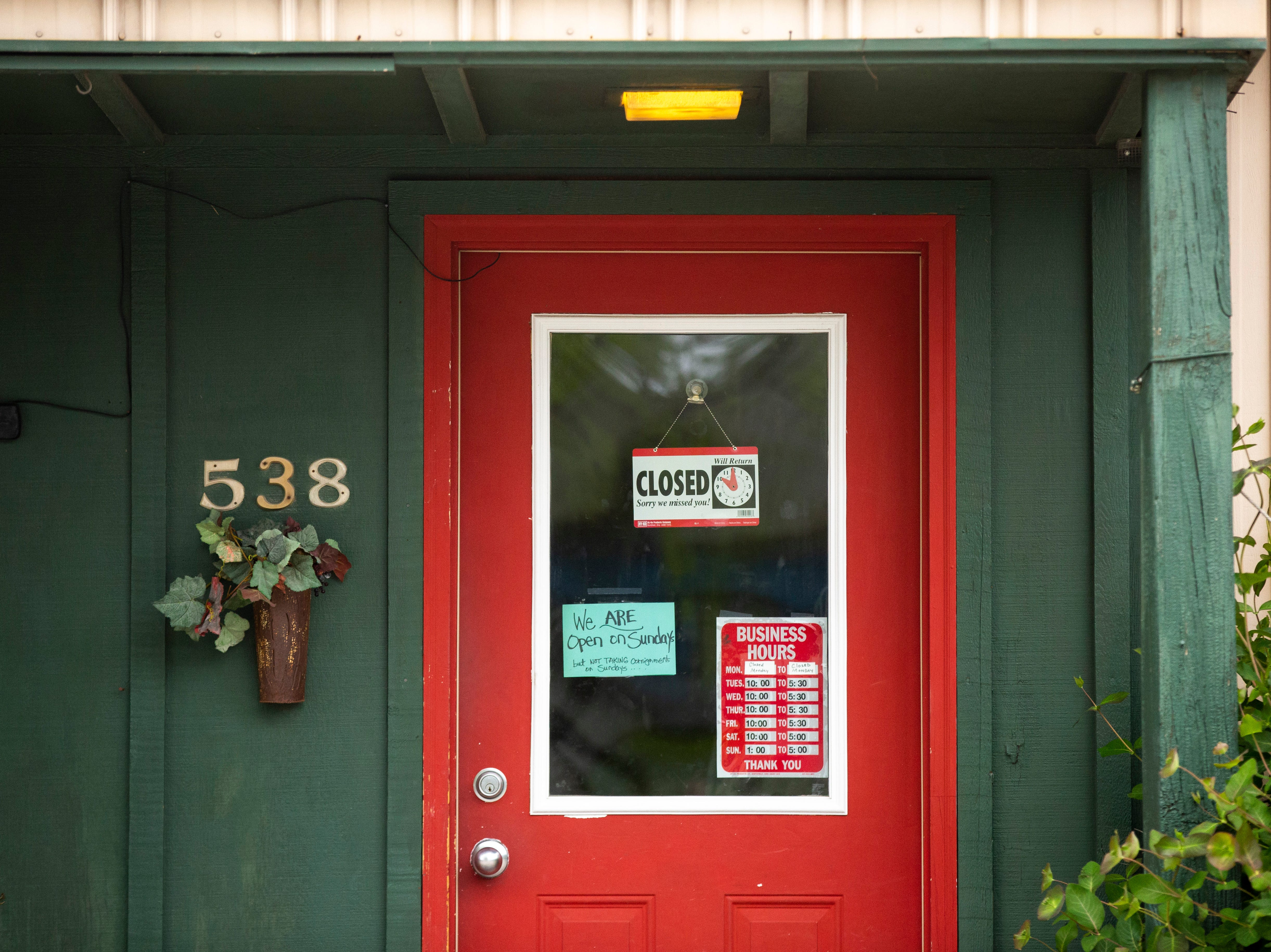 A door displaying hours at The Second Act is pictured, Thursday, May 9, 2019, at 538 Olympic Court, south of Highway 6 in Iowa City, Iowa.