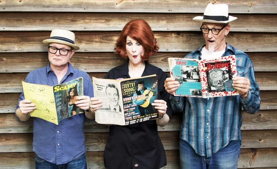 The North Carolina based band Southern Culture on the Skids  is composed of drummer Dave Harman (left), bassist/singer Mary Huff (center) and guitarist/singer Rick Miller (left).