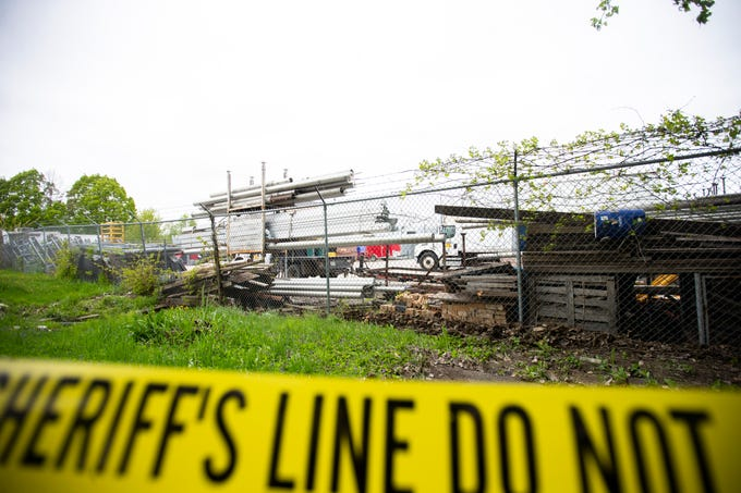 Yellow sheriff's tape is pictured, Thursday, May 9, 2019, behind The Second Act and Big Ten Rentals properties south of Highway 6 in Iowa City, Iowa.