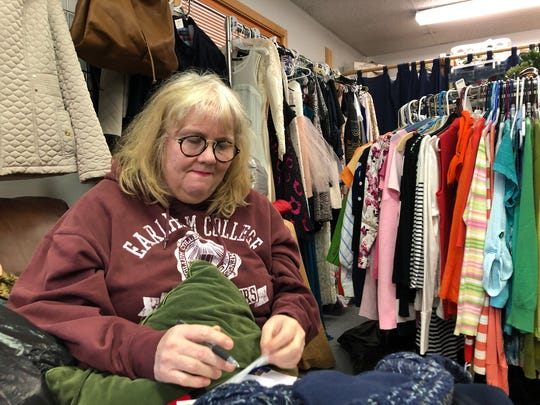 Melissa Williams, co-owner of The Second Act consignment store, prepares to close her shop early for the day after an officer-involved shooting occurred behind her property Thursday, May 9, 2019. Officers responded to the store for a burglary investigation.