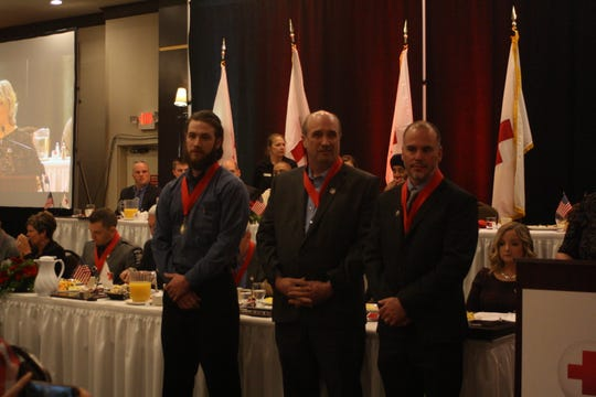 Rusty Crispell, Taylor Crispell and Andrew Dean receive the Good Neighbor Award at the American Red Cross of the Southern Tier's Real Heroes Breakfast on Thursday morning.