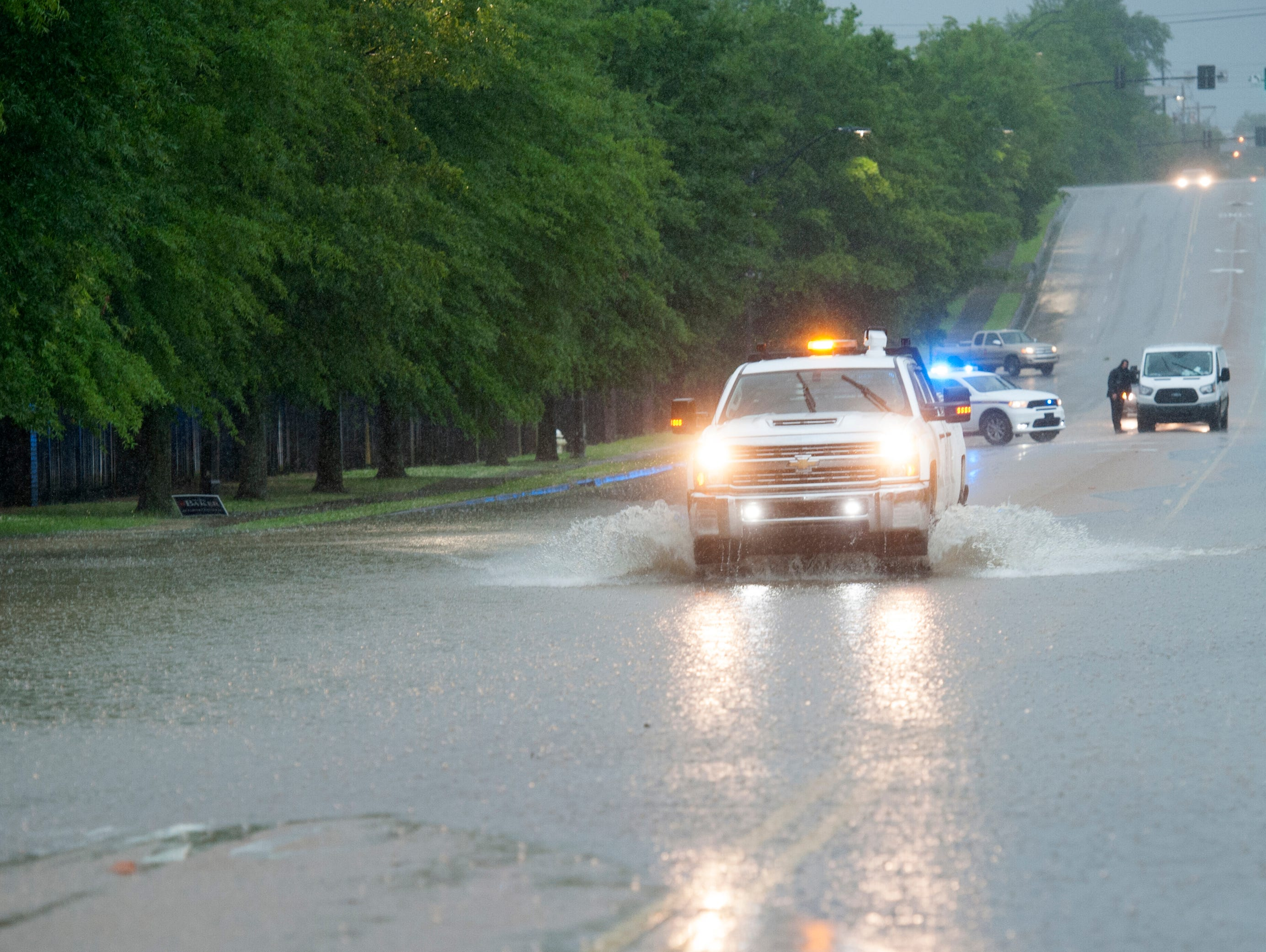 Some motorists venture into flood waters on the east end of High Street in Jackson, regardless of the police warning. Thunderstorms are expected to continue throughout the morning with rain tapering off this evening. Thursday, May 9, 2019