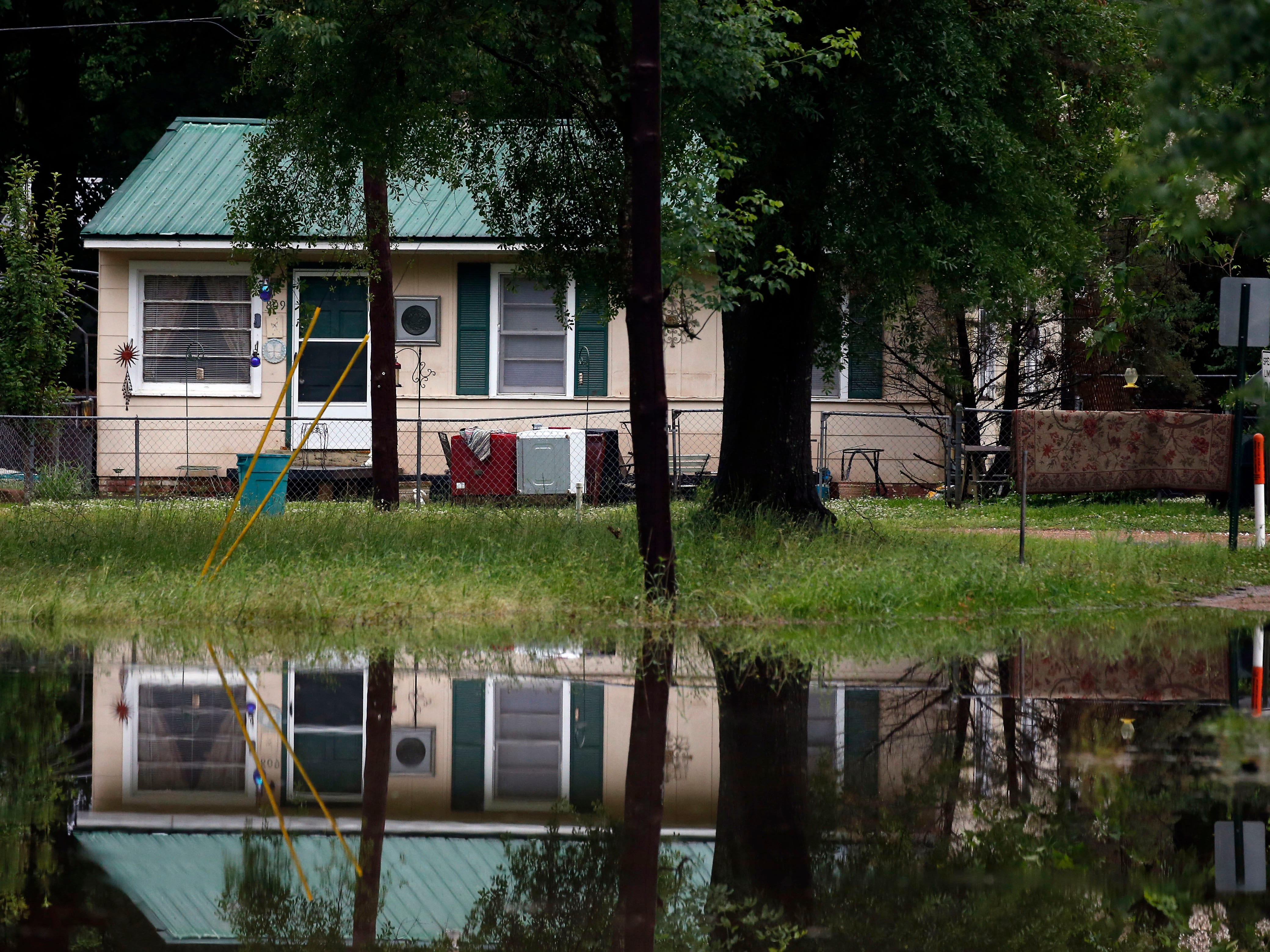A number of homes along Hilda Street in Pearl, Miss., were bordered by the morning flash flood waters, Thursday, May 9, 2019. Strong winds, tornado warnings and substantial rains added to the flash flooding throughout Mississippi.