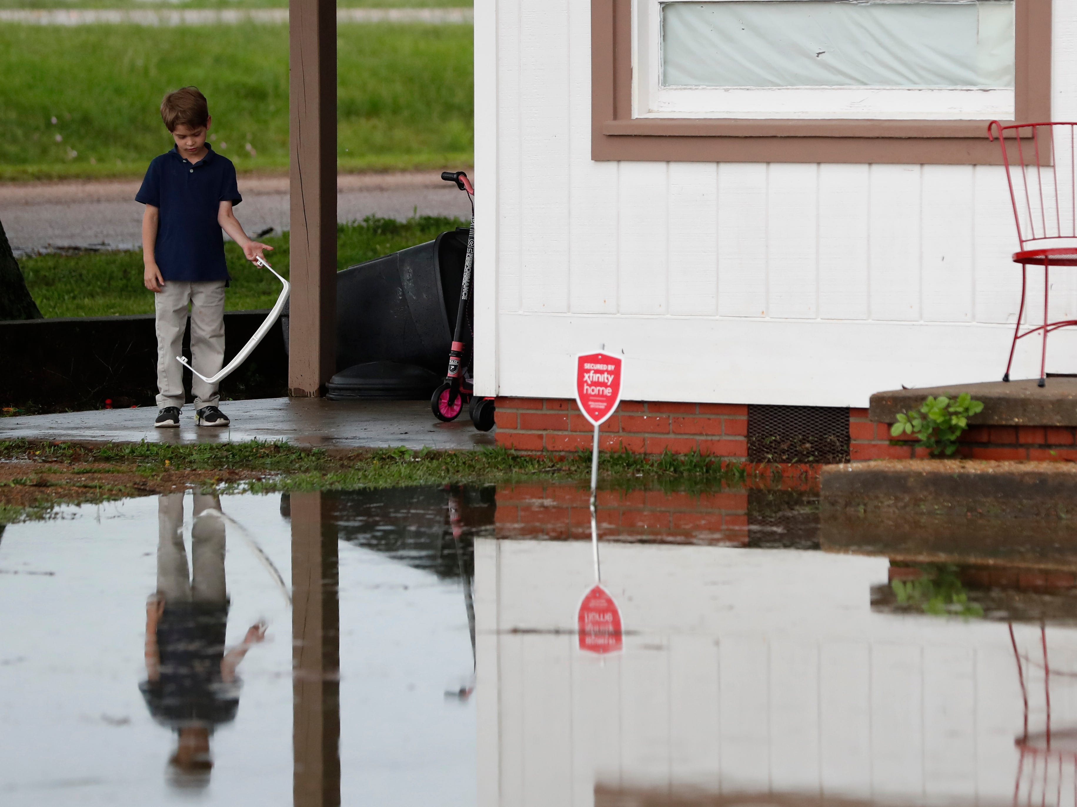 Trevor Clardy, 6, looks at flood waters outside his Pearl, Miss., Thursday, May 9, 2019. Strong winds, tornado warnings and substantial rains added to the flash flooding throughout Mississippi.