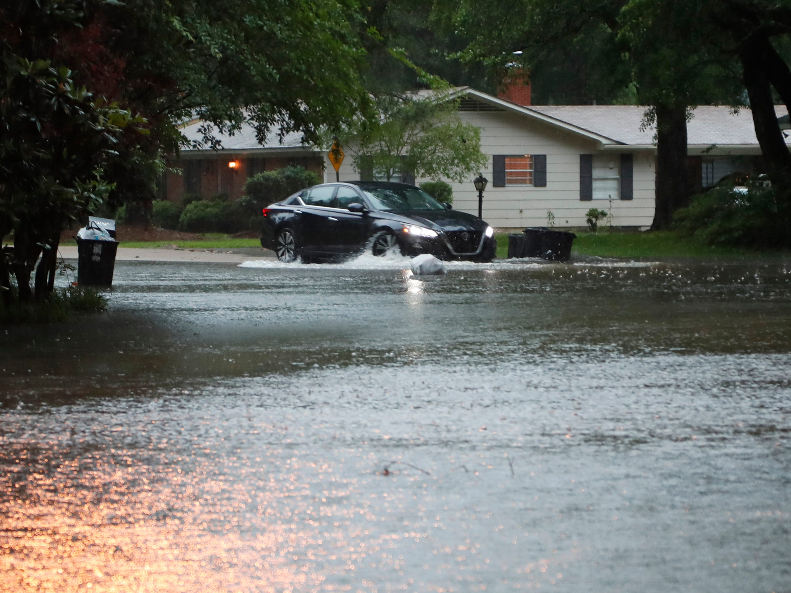 A driver in this northeast Jackson, Miss., neighborhood attempts to backup after first entering a flood street, Thursday, May 9, 2019. Strong winds, tornado warnings and substantial rains added to the flash flooding throughout Mississippi.