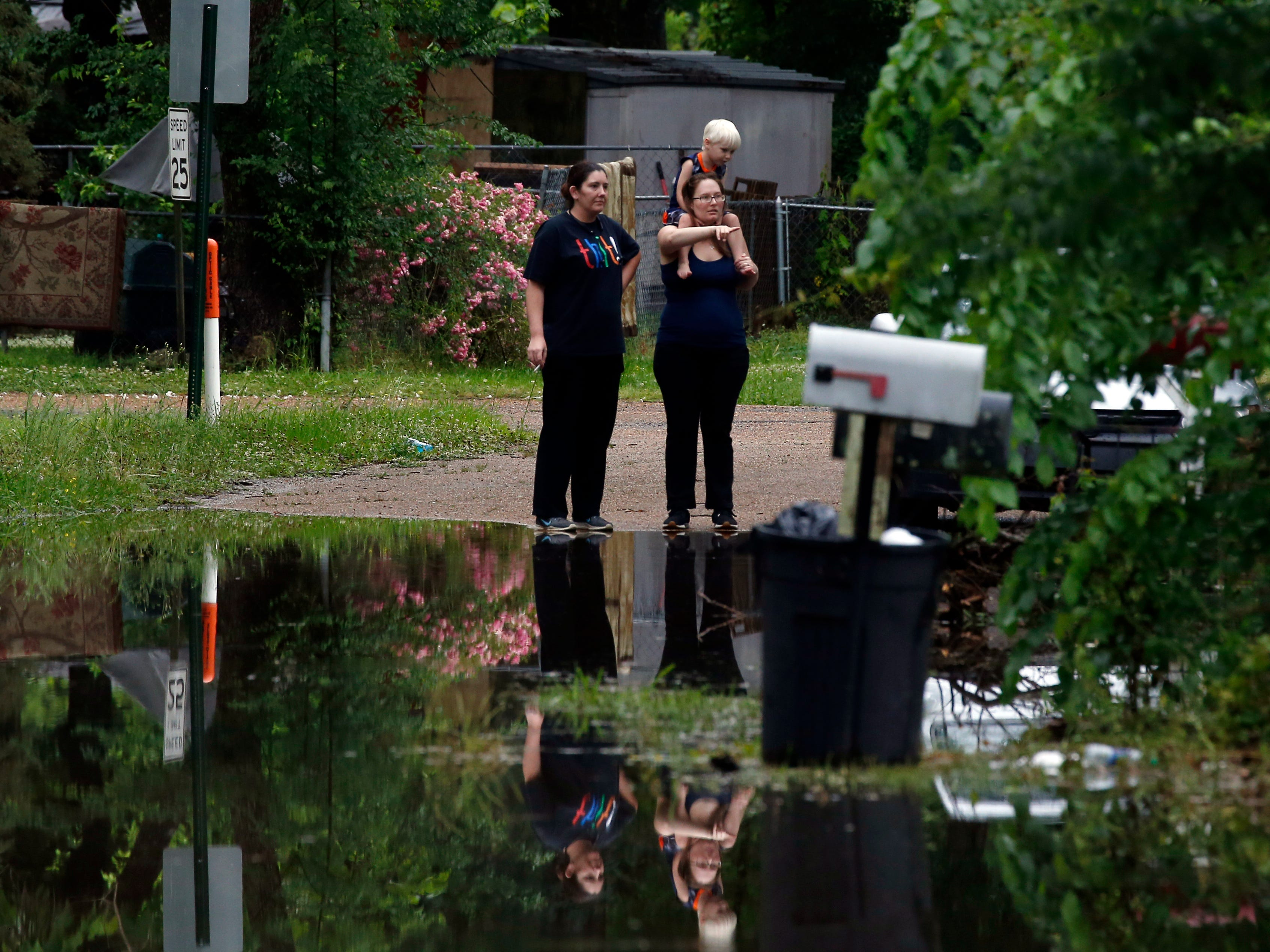 Residents in Pearl, Miss., watch as the morning flash flood waters begin to draw up, Thursday, May 9, 2019. Strong winds, tornado warnings and substantial rains added to the flash flooding throughout Mississippi.