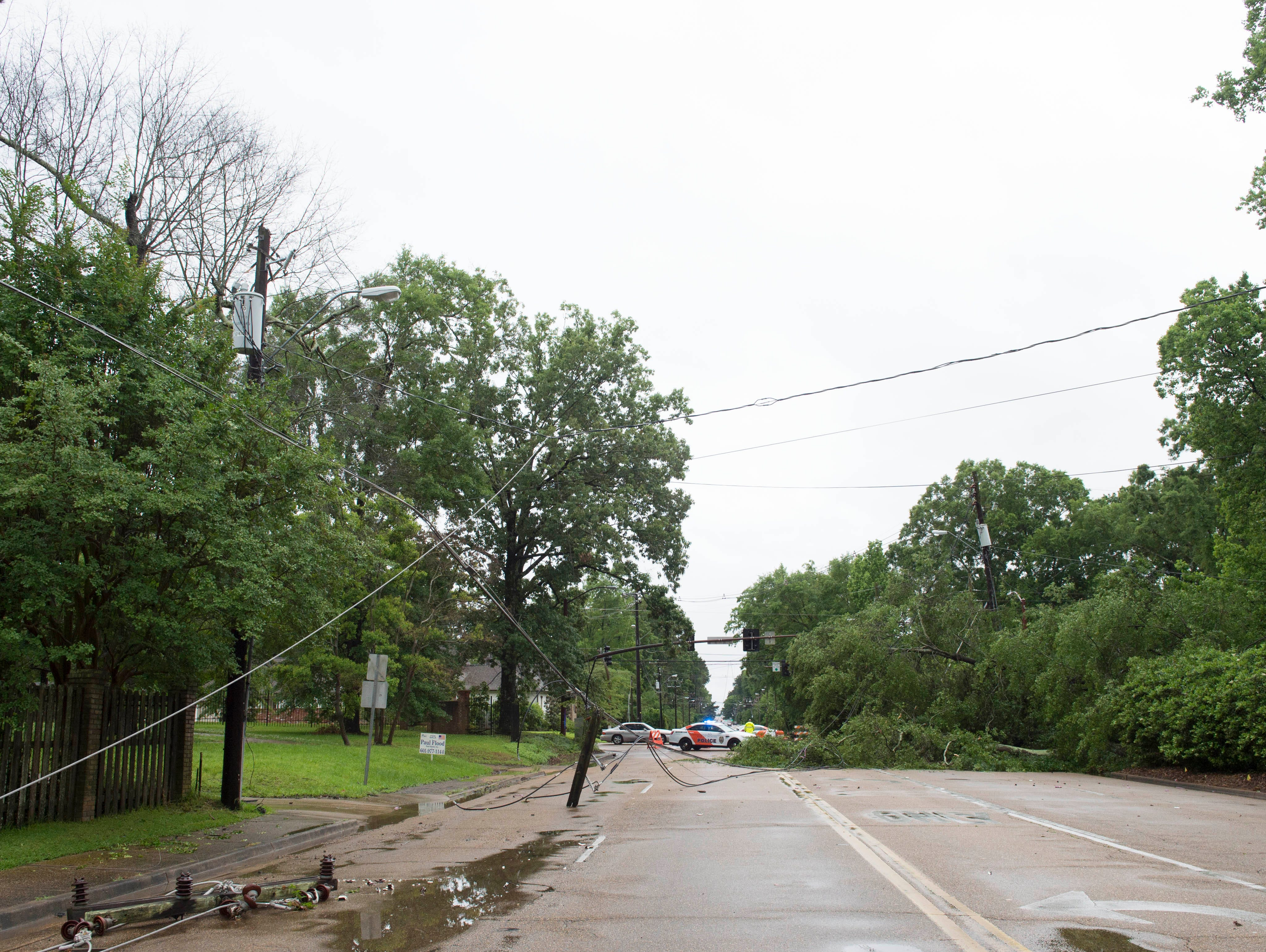 A fallen tree pulled power lines down along Ridgewood road near the intersection at Northside drive in Jackson. The incident caused traffic lights to go out and altered traffic along Ridgewood road. Thursday, May 9, 2019.