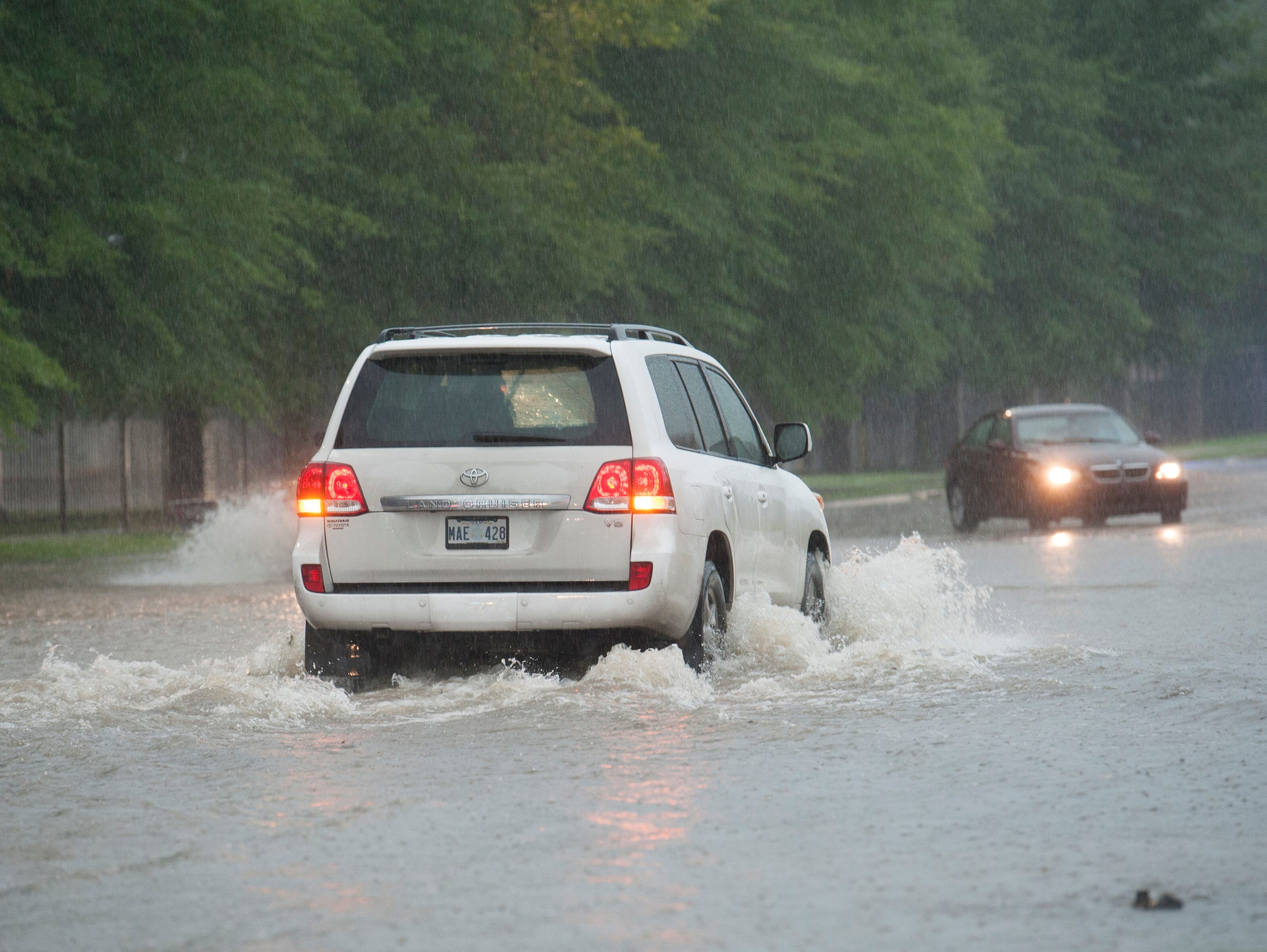 Some drivers decide to attempt going through flood waters on the east end of High Street Thursday morning regardless of warnings by Jackson Police cruisers with flashing lights. Thunderstorms are expected to continue throughout the morning with rain tappering off this evening. Thursday, May 9, 2019