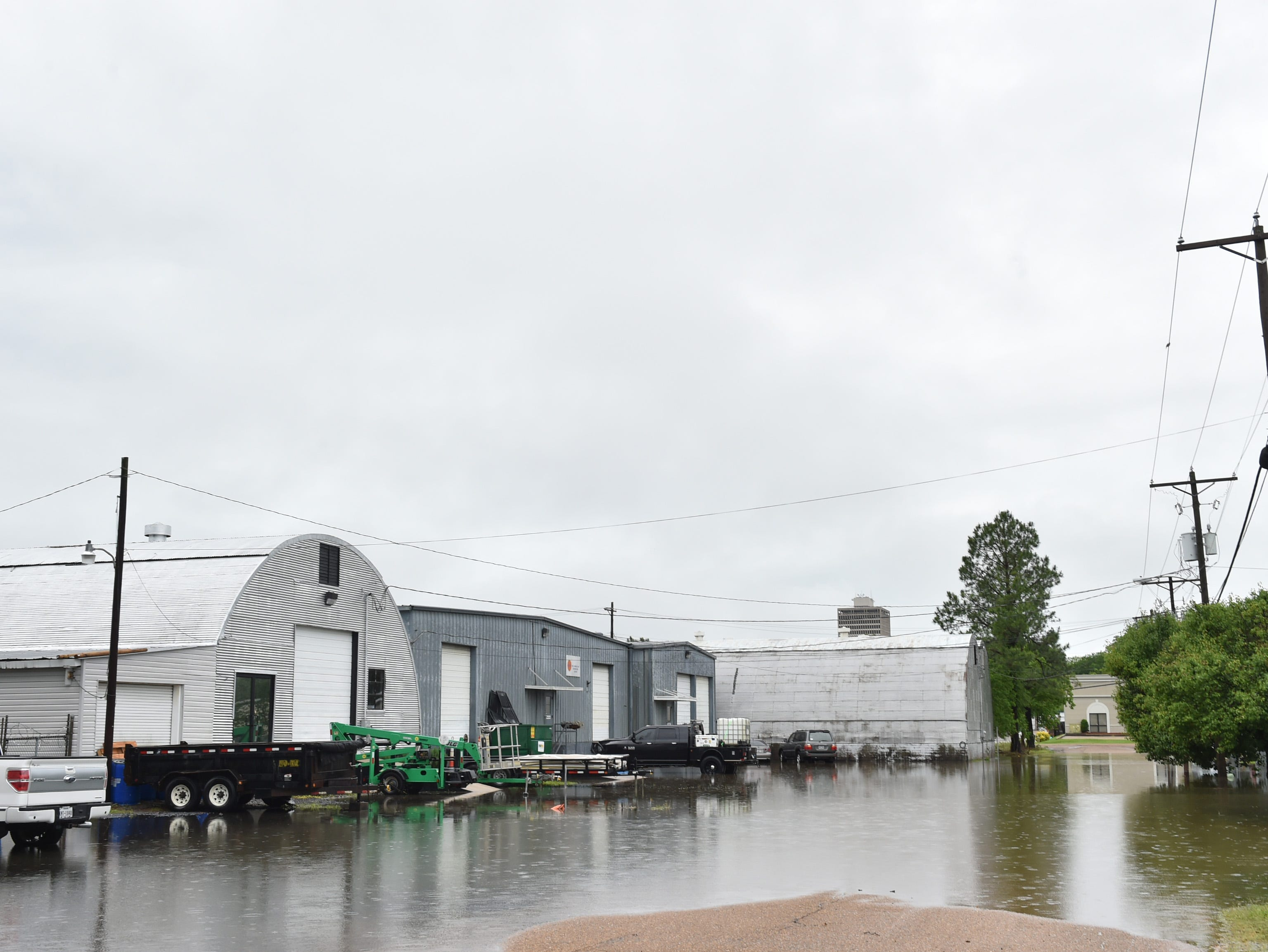 Flooding overtook sections of Vine street between Lamar and Monroe streets in Jackson near the High street exit of I-55. Thursday, May 9, 2019.