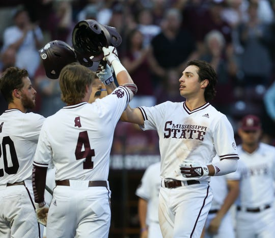 Mississippi State's Marshall Gilbert (34) is congratulated by Mississippi State's Rowdey Jordan (4) and Mississippi State's Luke Hancock (20) after hitting a home run. Mississippi State played Memphis in a college baseball game on Wednesday, May 8, 2019. Photo by Keith Warren