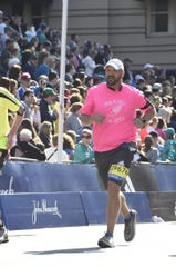 Jackson native Scott Stader ran in Cincinnati's Flying Pig Marathon on May 5, his 50th marathon in the 50th state.