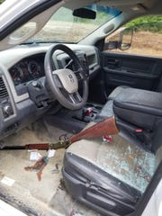 A stolen gun rests inside the cab of a truck also allegedly stolen by 32-year-old Michael Bolin Sunday.