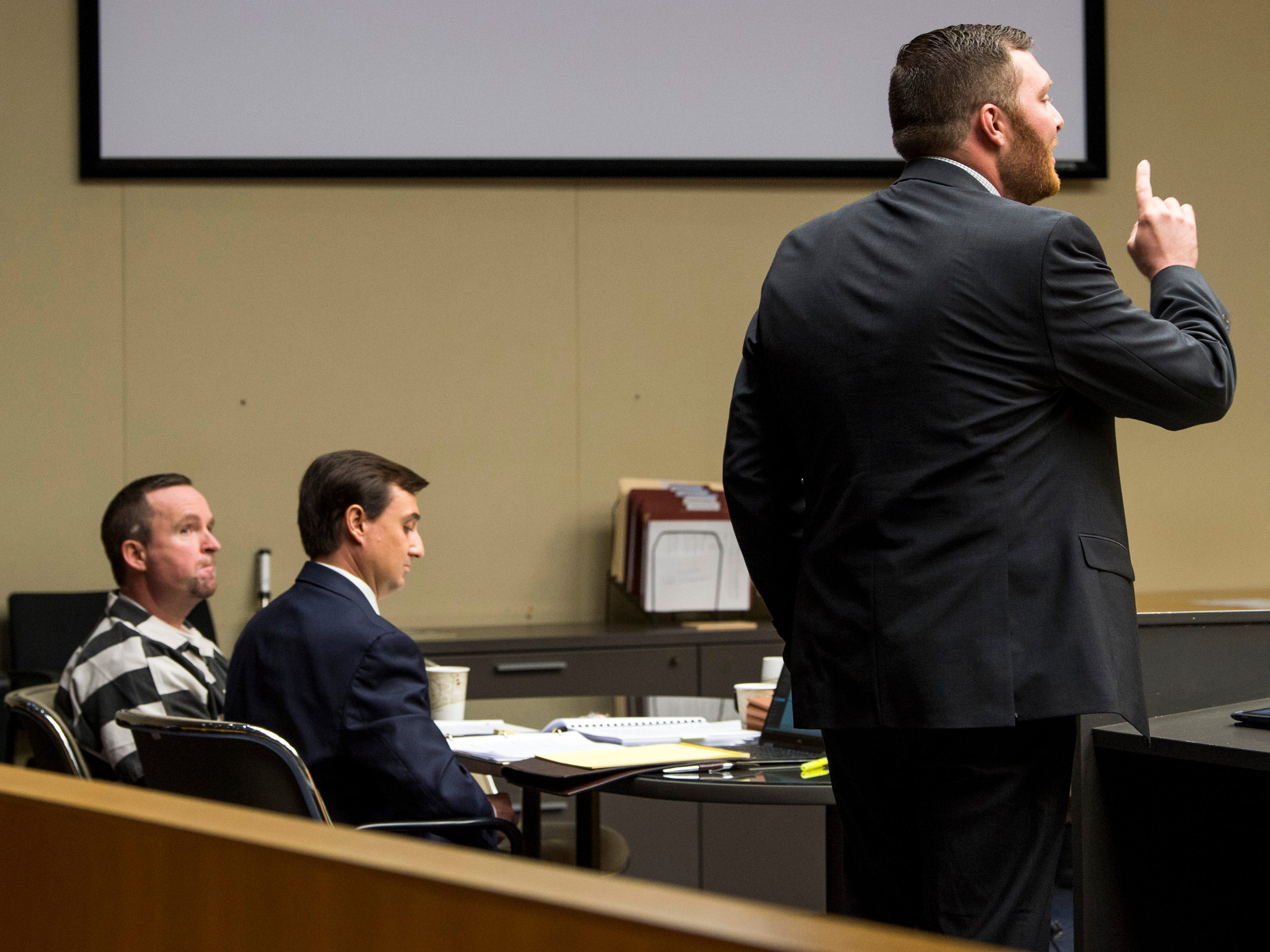 David Lynn Richards, left, listens as Assistant District Attorney General Nathaniel Ogle, right, gives the state's argument during Richards' sentencing hearing in Knox County Criminal Court on Thursday, May 9, 2019.