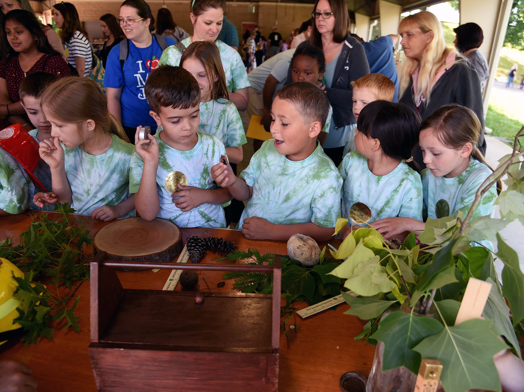 Students marvel over the bugs and plants at the Tennessee Division of Forestry display during Farm Day. Over 600 Knox County School children attended the annual Knox County Farm Bureau Ag in the Classroom Farm Day at Chilhowee Park Tuesday, May 7, 2019.