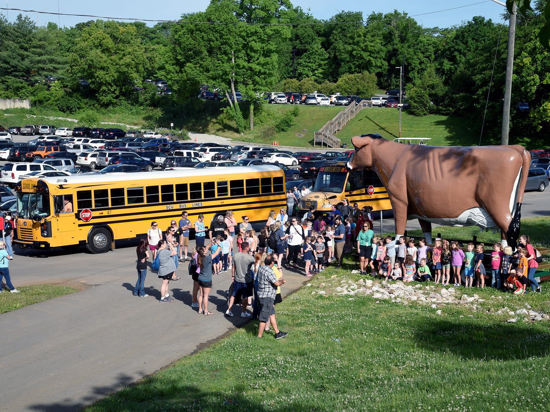 Knox County School children line up in front of the Mayfield Cow for a Picture.  Over 600 Knox County School children attended the annual Knox County Farm Bureau Ag in the Classroom Farm Day at Chilhowee Park Tuesday, May 7, 2019.