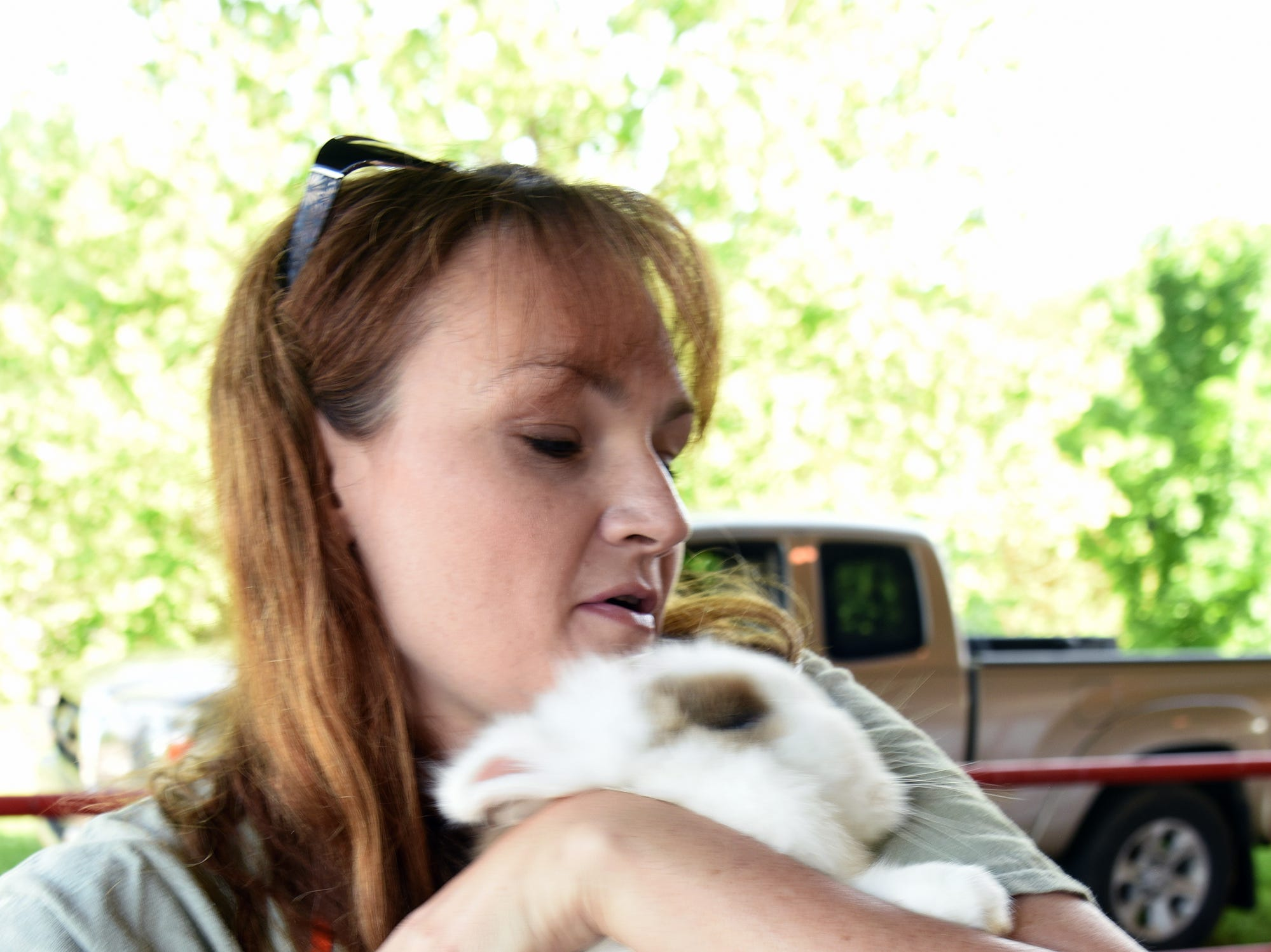 Shannon Ross holds a Lion head Rabbit.  Over 600 Knox County School children attended the annual Knox County Farm Bureau Ag in the Classroom Farm Day at Chilhowee Park Tuesday, May 7, 2019.