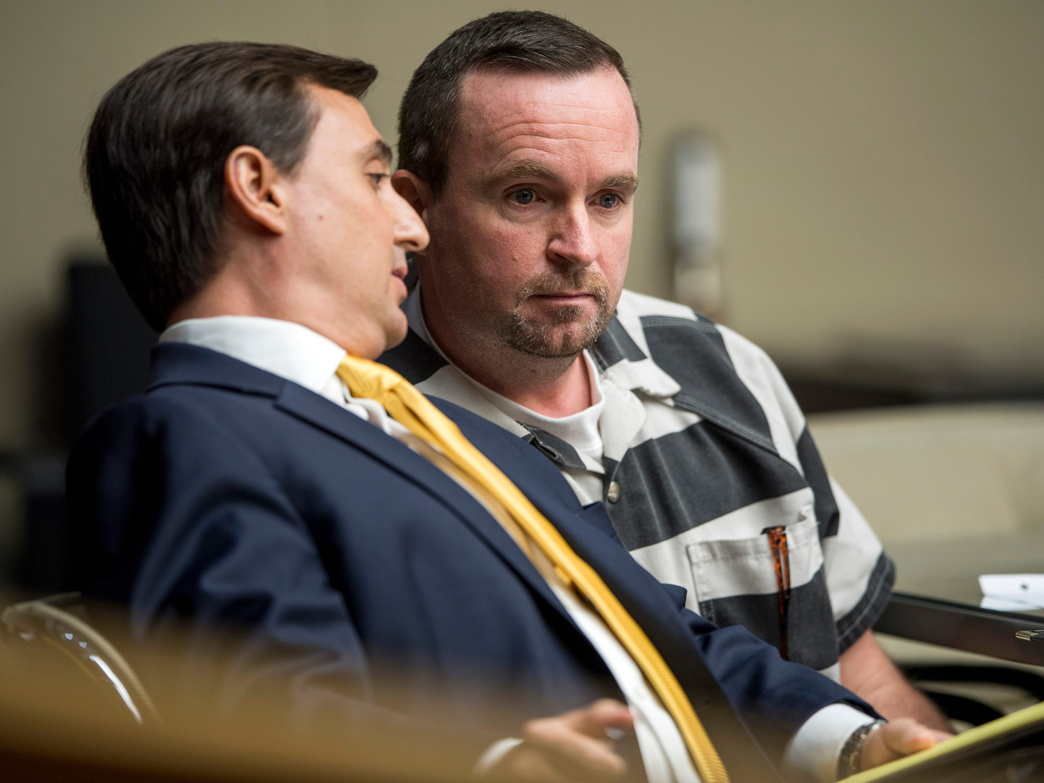 Attorney Stephen Ross Johnson, left, leans over to talk to David Lynn Richards during Richards' sentencing hearing in Knox County Criminal Court on Thursday, May 9, 2019.