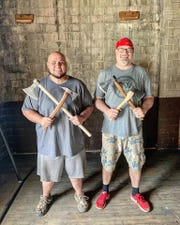Patrons to KnoxAxe, which will have a soft opening in June, will be able to choose from a variety of axes. Craig VanGorder and Tito Wilson demonstrate a few options.