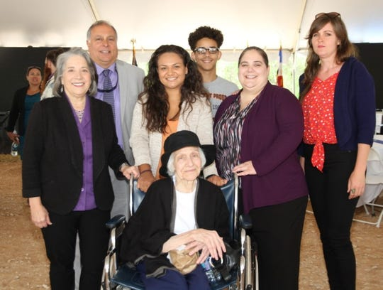 Knox County Mayor Madeline Rogero and other members of her family stand with her mother, Anita Waugh, at the 2019 State of Knoxville address last month. From left are Rogero's husband, Gene Monaco; granddaughter, Jada Torney; grandson, Silas Cole; daughter Carmen Rogero Pitt; and daughter Joan Monaco.""