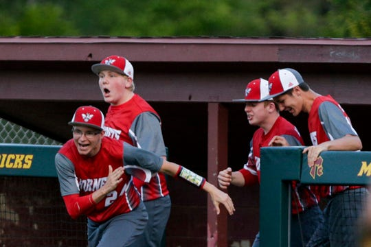 The Rossville dugout clears as they celebrate defeating McCutcheon, 7-6, Wednesday, May 8, 2019, at McCutcheon High School in Lafayette.